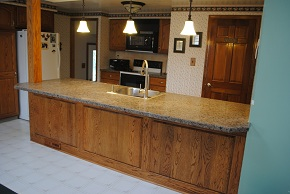 Custom Kitchen with Avonite Countertops, Armstrong Cabinets, and Armstrong Linoleum Flooring